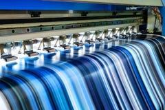 Large inkjet printer working multicolor on vinyl banner. Large inkjet printer working multicolor cmyk on vinyl banner Stock Image