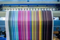 Large inkjet printer working multicolor on vinyl banner. Large inkjet printer working multicolor cmyk on vinyl banner Stock Photos