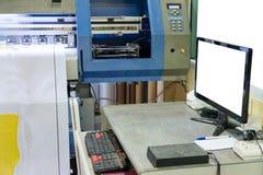 Large inkjet printer working on vinyl banner with computer scree. Large inkjet printer working on vinyl banner with computer control Stock Photography