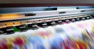 Large inkjet printing machine. During production on vinyl banner royalty free stock image