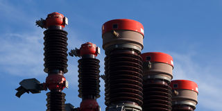 Large insulators. High capacity insulators of a power station facility Royalty Free Stock Photo