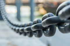 Large Iron Chain Fades out of Focus. In Boston Stock Images