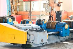 A large iron machine for the manufacture of metal parts, spare parts in the industrial premises of the shop stock photos