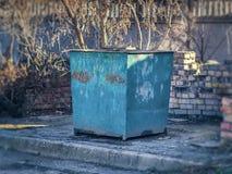 Large iron trash bin in the yard Royalty Free Stock Photos