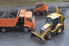 Large jackhammer and wheel mini excavator royalty free stock photography