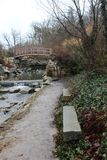 A large japanese garden and a small brook full of stones stock images
