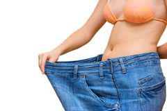 Large jeans. Girl in too large jeans Stock Image
