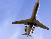 Large Jet Aircraft. Large Arcraft -view from underneath at low altitude royalty free stock photos