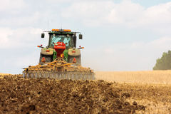 Large John Deere tractor working field Royalty Free Stock Photos