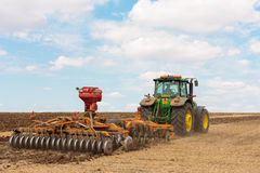 Large John Deere tractor working field Stock Photos