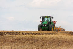 Large John Deere tractor working field Stock Images