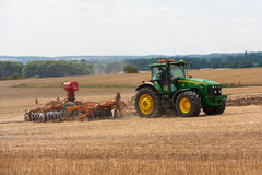 Large John Deere tractor working field Royalty Free Stock Photography