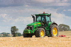 Large John Deere tractor working field Stock Photography