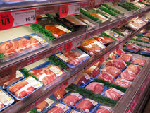 Large joints of meat in a store fridge. Stock Image