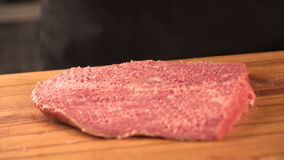 Large juicy piece of meat on a chalkboard. farm products stock footage