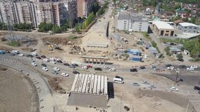 Large junction under construction, aerial view, difficult car traffic, sunny summer day. 4K stock footage