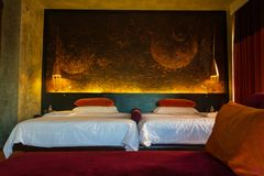 Large king size bed in decorative moody room royalty free stock photo