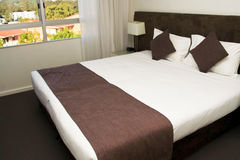 Large king size luxury hotel bed Stock Photo