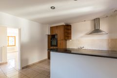 Spacious and equipped kitchen in a house stock photography
