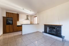 Empty eat-in kitchen with fireplace royalty free stock photo
