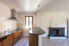 Eat-in kitchen with fireplace in a house stock photos