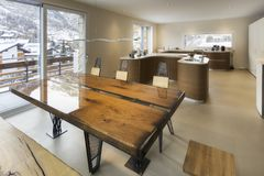 Large kitchen and antique wood table in modern style Stock Images