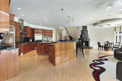 Large kitchen with black fireplace Stock Images