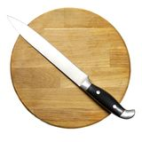Large kitchen knife on a wooden board Stock Images