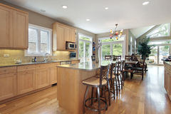 Large kitchen with oak cabinetry Royalty Free Stock Image