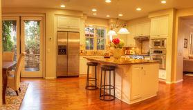 Large kitchen with recessed lighting, wood floors Stock Photo