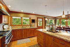 Large kitchen room with decorated island Royalty Free Stock Image