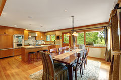 Large kitchen room with elegant dining table set stock image