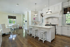 Large kitchen with white cabinetry Stock Image