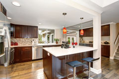 Large kitchen with white counter tops. Royalty Free Stock Photography