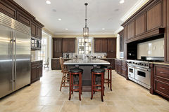 Large kitchen with wood cabinetry Royalty Free Stock Photography