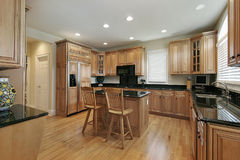 Large kitchen with wood cabinetry Royalty Free Stock Photo