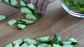 A large knife on the board chopped cucumbers stock video footage