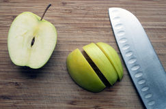 Large knife on a wooden board Royalty Free Stock Image