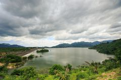 Large Lake among Hills under Grey Clouds in Vietnam Stock Photos