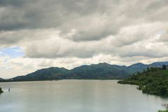 Large Lake among Hills under Grey Clouds in Vietnam Royalty Free Stock Photos