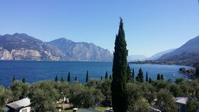 Large lake with mountains in the background. View over the Garda lake, Italy royalty free stock photography