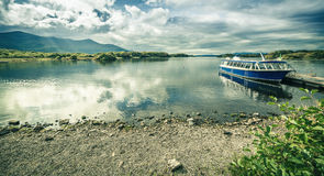 Large lake with a parked water taxi. Large lake with parked a water taxi, clear water with cloudy sky royalty free stock photos