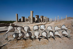 Large lamps, illuminated at night the ruins of the old city of Persepolis, Iran. Stock Photos