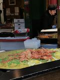 Langustinos are added to Paella at a lunch stall in Borough Market, London. Large langustino shrimp are added to a trough of Paella de Valencia in a lunch stall royalty free stock photos