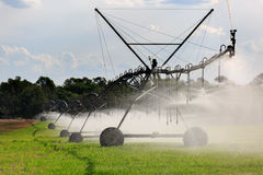 Large Lateral Move Irrigation System. A Lateral Move Irrigation System, sometimes called a Linear Move, Wheelmove or Side Roll System, irrigating crops in Royalty Free Stock Images