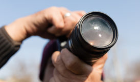 A large lens in the camera of a man.  royalty free stock photography