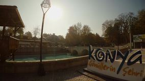 Large letters of KONYA near the old canal and the Roman bridge. KONYA / TURKEY - 11.20.2016 central streets of the ancient Turkish city stock video