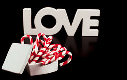 Large letters LOVE and Heart Lollipop isolated on black - Stock Stock Images