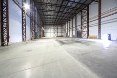 Large light empty hangar Stock Photos