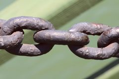 Large links of the old metal chain. Background texture of old metal. stock photography